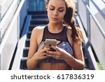woman in sport wear using... | Shutterstock . vector #617836319