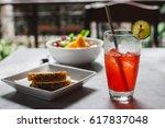 hibiscus red ice tea served on... | Shutterstock . vector #617837048