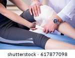 traumatologist is taking care... | Shutterstock . vector #617877098