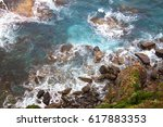 waves against the bottom of the ... | Shutterstock . vector #617883353