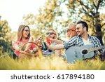 friends having fun outdoors... | Shutterstock . vector #617894180