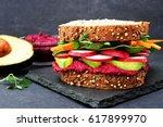 superfood sandwich with beet... | Shutterstock . vector #617899970