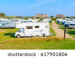 SYLT ISLAND, GERMANY - SEP 8, 2016: campers on green area of camping site on beautiful island of Sylt, Germany. - stock photo