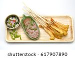 barbecued shrimp skewers with... | Shutterstock . vector #617907890