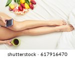 overhead shot of slim tanned... | Shutterstock . vector #617916470