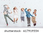 happy group of kids jumping in... | Shutterstock . vector #617919554