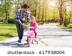 happy young father teaching... | Shutterstock . vector #617938004