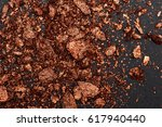 brown shiny crumbled powder... | Shutterstock . vector #617940440