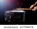 the drum sticks are hitting on... | Shutterstock . vector #617998478