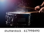 the drum sticks are hitting on... | Shutterstock . vector #617998490