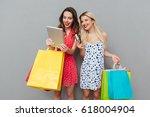two happy women in dresses