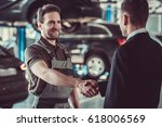 handsome mechanic and... | Shutterstock . vector #618006569