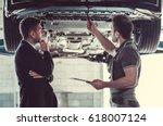 handsome mechanic and... | Shutterstock . vector #618007124