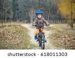 child on a bicycle in the... | Shutterstock . vector #618011303