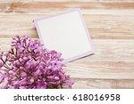 purple lilac branch on wooden...   Shutterstock . vector #618016958