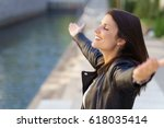 grateful woman with eyes closed ... | Shutterstock . vector #618035414