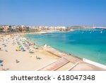 pretty bay at birzebbuga  malta ... | Shutterstock . vector #618047348