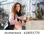 cheerful young woman looking at ... | Shutterstock . vector #618051770