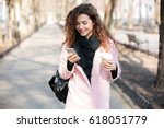 Cheerful Young Woman Wearing...
