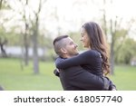 beautiful young couple in park | Shutterstock . vector #618057740