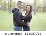 beautiful young couple in park | Shutterstock . vector #618057758