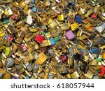 Small photo of Paris, France - December 11, 2013: Thousands of padlocks known as love locks adorn the Pont des Arts bridge. Golden padlocks sunny background. Conjugal ties for ever. Famous landmark and attraction