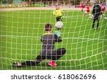 a child  a goalkeeper in... | Shutterstock . vector #618062696