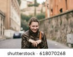 girl in rome laughing on a... | Shutterstock . vector #618070268