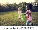 little kids separating recycle... | Shutterstock . vector #618072170