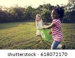 little kids separating recycle... | Shutterstock . vector #618072170