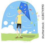 Boy Holding A Huge Kite On A...