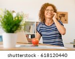 middle aged woman at office... | Shutterstock . vector #618120440