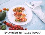 bruschetta with cheese  basil ... | Shutterstock . vector #618140900