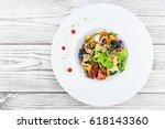 fresh salad with tuna  arugula  ... | Shutterstock . vector #618143360