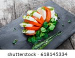 caprese salad with mozzarella... | Shutterstock . vector #618145334