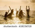 silhouettes of young group of... | Shutterstock . vector #618156518