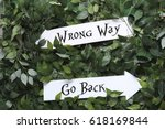 Small photo of Right and wrong signs (Alice in Wonderland)