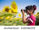cute little girl takes picture... | Shutterstock . vector #618186233