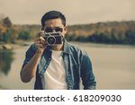 young man tourist  standing and ... | Shutterstock . vector #618209030