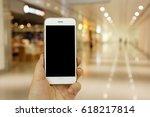 hand holding mockup smartphone... | Shutterstock . vector #618217814