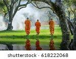 Three Monks Walking In The Par...