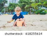 Kid Playing On The Beach With...