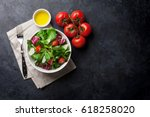 healthy salad bowl on stone... | Shutterstock . vector #618258020