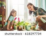 cute child girl helps her... | Shutterstock . vector #618297734