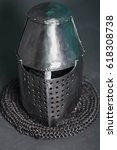 Small photo of Knight's helmet and chainmail hood. Gray background. Topfhelm. Coif.