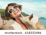 Stock photo dog kisses his owner 618332486