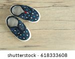blue kid shoes  put on wood... | Shutterstock . vector #618333608