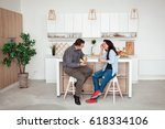 attractive couple sitting... | Shutterstock . vector #618334106