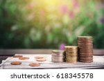 stack coins and dollar cash on... | Shutterstock . vector #618345578
