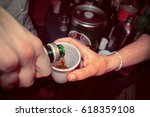 Small photo of hand pours alcohol in the glass, alcoholism concept